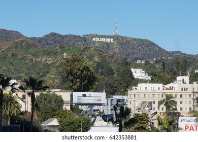 LOS ANGELES, FEB 23RD, 2017: Wide shot of the Hollywood sign in the mountains above Los Angeles against a blue sky.