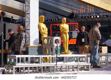 LOS ANGELES, FEB 23RD, 2017: Workers surround two Oscar statues in the red carpet area for the 2017 Academy Awards.