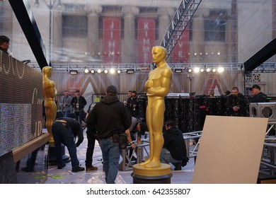 LOS ANGELES, FEB 23RD, 2017: An Oscar statue stands abandoned in the red carpet area of the 2017 Academy Awards with host Jimmy Kimmel's marquee visible in the background.