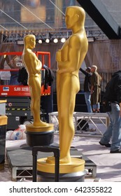 LOS ANGELES, FEB 23RD, 2017: Close up of two large, golden Oscar statues, facing one another, on the red carpet area for the 2017 Academy Awards.