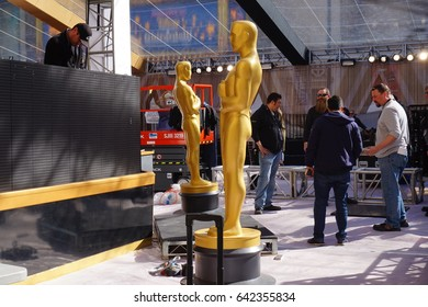 LOS ANGELES, FEB 23RD, 2017: Medium shot of two large, golden Oscar statues on the red carpet area for the 2017 Academy Awards.