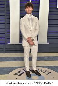 LOS ANGELES - FEB 24:  Joe Jonas arrives for the Vanity Fair Oscar Party on February 24, 2019 in Beverly Hills, CA