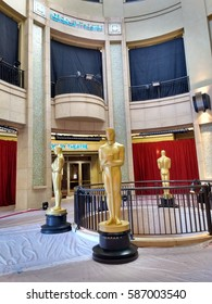 LOS ANGELES, FEB 24TH, 2017: Large golden Oscar statues guard the entrance to the Dolby Theatre where the Academy Awards are held.