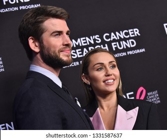 """LOS ANGELES - FEB 28:  Liam Hemsworth and Miley Cyrus arrives to """"An Unforgettable Evening""""  on February 28, 2019 in Hollywood, CA"""