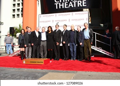 LOS ANGELES - FEB 4: Billy Crystal, Robert DeNiro, Grace Hightower, David O. Russell at the Robert DeNiro Hand & Footprint Ceremony  at the Chinese Theater forecourt on Feb 4, 2013 in Los Angeles, CA