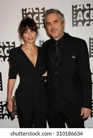 LOS ANGELES - FEB 7:  Alfonso Cuaron and Sheherazade Goldsmith arrives at the 64th Annual ACE Eddie Awards   on February 7, 2014 in Beverly Hills, CA