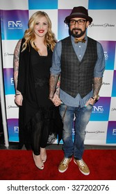 LOS ANGELES - FEB 8 - AJ Mclean and wife arrives at the 16th Annual Friends N Family Pre Grammy Party on February 8, 2013 in Los Angeles, CA