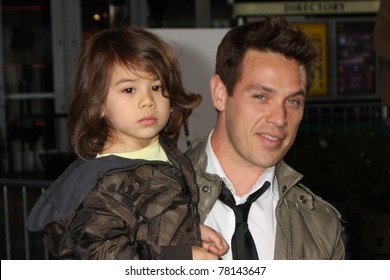 LOS ANGELES - FEB 8:  Kevin Alejandro, family arrives at the premiere of Paramount Pictures' 'Justin Bieber: Never Say Never' at Nokia Theater L.A. Live on February 8, 2011 in Los Angeles, CA