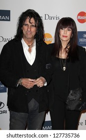 LOS ANGELES - FEB 9:  Alice Cooper, Sheryl Goddard arrives at the Clive Davis 2013 Pre-GRAMMY Gala at the Beverly Hilton Hotel on February 9, 2013 in Beverly Hills, CA