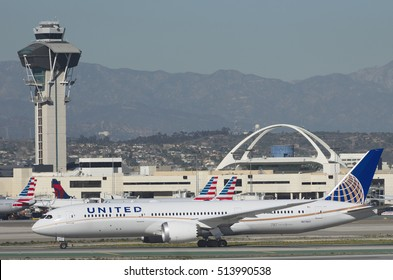 LOS ANGELES, FEBRUARY 15, 2016: United Airlines Dreamliner (Boeing 787-9, registration N27957) taxing at LAX, The landmark Theme Building and the control tower are in the middle ground.