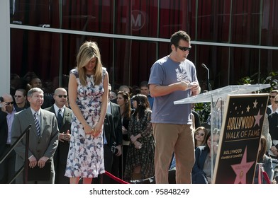 LOS ANGELES - FEBRUARY 22: Actor-comedian Adam Sandler speaks at the Jennifer Aniston Hollywood Walk of Fame Star Ceremony at Hollywood Blvd on February 22,  2012 in Los Angeles, CA.