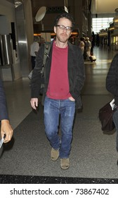 LOS ANGELES - FEBRUARY 8 : Ethan Cohen, writer/producer of such classics as Big Lebowski, No Country For Old Men, Fargo and Tru Grit,  arrives at LAX on February 8, 2011 in Los Angeles, California