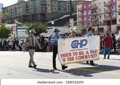 LOS ANGELES - FEBRUARY 9, 2019: California Highway Patrol Officers and Banner at the Los Angeles Chinese New Year Parade.
