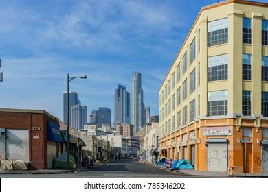 Los Angeles, JAN 1: Homeless tent and dirty road with downtown skyline on JAN 1, 2018 at Los Angeles, California, United States