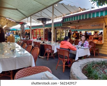 LOS ANGELES, JAN 14, 2017: Patrons sit on the patio at one of the Restaurants at the historic Farmers Market at 3rd and Fairfax, near the Grove shopping mall, in Los Angeles.