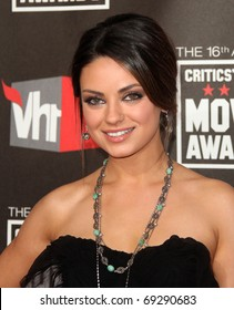 """LOS ANGELES - JAN 14:  Mila Kunis arrives at the 16th Annual """"Critics"""" Choice Movie Awards  on January 14, 2011 in Los Angeles, CA"""