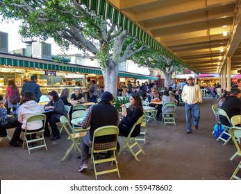 LOS ANGELES, JAN 14TH, 2017: People are sitting at tables, eating lunch at the outdoor dining area at the famous Farmers Market at 3rd and Fairfax in Los Angeles, California.