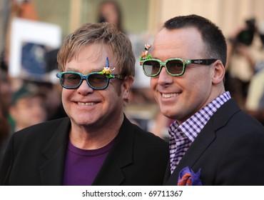 "LOS ANGELES - JAN 23:  Elton John & David Furnish arrive at the ""Gnomeo & Juliet"" World Premiere  on January 23, 2011 in Los Angeles, CA"