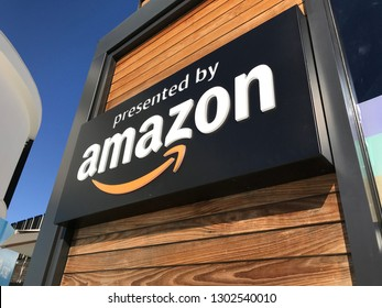 LOS ANGELES, Jan 25th, 2019: Side angle close up view of the Amazon logo located at the Amazon store at the Westfield Century City shopping mall, against a blue sky.