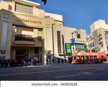 LOS ANGELES, JAN 26TH, 2016: Street view with tourist bus of the Dolby Theatre (formerly Kodak Theatre) on the Hollywood Walk of Fame where the famous Academy Awards (Oscars) are held.