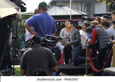 """LOS ANGELES - JAN 31: Mario Lopez films the television show """"Extra"""" at The Grove in Los Angeles, CA on January 31,  2012."""