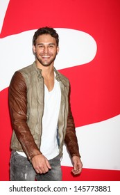 "LOS ANGELES - JUL 11:  Ryan Guzman arrives at the ""Red 2"" Premiere at the Village Theater on July 11, 2013 in Westwood, CA"