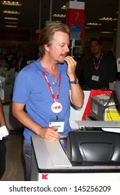 """LOS ANGELES - JUL 3:  David Spade clerks at K-Mart to support March of Dimes and promote the """"Grown Ups 2"""" movie at the K-Mart on July 3, 2013 in Los Angeles, CA"""