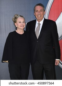 """LOS ANGELES - JUL 9:  Ivan Reitman and Genevieve Robert Reitman arrives to the """"Ghostbusters"""" World Premiere  on July 9, 2016 in Hollywood, CA"""
