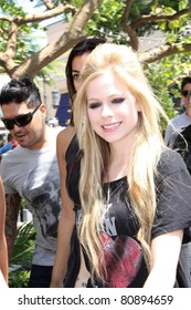 LOS ANGELES - JULY 12: Singer Avril Lavigne leaving The Grove after being interviewed for the entertainment program Extra by Mario Lopez July 12, 2011 Los Angeles, CA.
