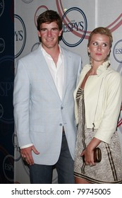 LOS ANGELES - JULY 15: Eli Manning and wife Abby at the 2008 ESPYs Giant Event in downtown Los Angeles, California on July 15, 2008.