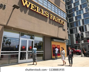 Los Angeles, July 16, 2018:  People walk past a Wells Fargo bank branch  on Wilshire Boulevard in Los Angeles.