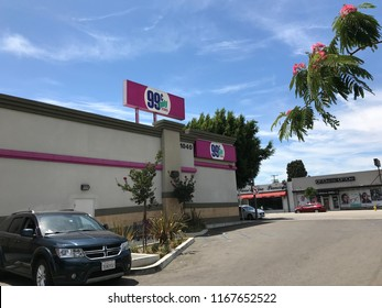LOS ANGELES, JULY 21, 2018: Wide shot of the building exterior of the 99 Cents Only store on Pico Boulevard in West LA, against a blue sky with white clouds.