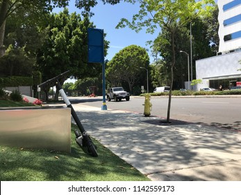 LOS ANGELES, JULY 25, 2018: A Bird scooter stands discarded on a sidewalk in West Hollywood, just in front of the Beverly Hills city limit. Beverly Hills has banned the devices, citing safety concerns
