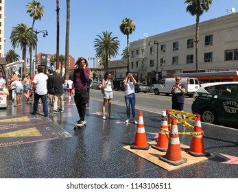 LOS ANGELES, JULY 26, 2018: People are walking past traffic cones on top of President Donald Trump's star on the Hollywood Walk of Fame on Hollywood Boulevard, after it was vandalized on July 24, 2018