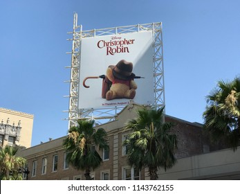 "LOS ANGELES, JULY 26, 2018:  A billboard advertising the new Disney movie ""Christopher Robin"" stands above palms on a building on Hollywood Boulevard's Walk of Fame. The movie opens August 3rd."