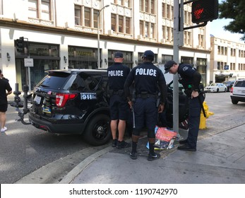 LOS ANGELES, JULY 26, 2018: LAPD police officers examine a suspicious package at the intersection of Hollywood Boulevard and Sycamore Ave.