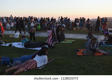 Los Angeles - JULY 4, 2018: A lot of people are gathered in Griffith Observatory to watch the 4th of July fireworks celebration on July 4, 2018 at Los Angeles, CA