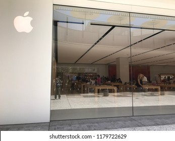 LOS ANGELES, JULY 7, 2018: Customers inside the Apple store at the Westfield Century City mall, seen through the store's glass panels.
