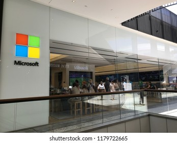 LOS ANGELES, JULY 7, 2018: Customers inside the Microsoft store at the Westfield Century City mall, seen through the store's glass panels.