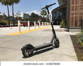 LOS ANGELES, JULY 7TH 2018: Low angle close up of a Bird scooter standing abandoned on the sidewalk in front of the Westfield shopping mall on Santa Monica Boulevard in Century City.
