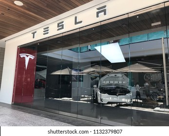 LOS ANGELES, JULY 7TH 2018: The Tesla dealership showroom at the Westfield shopping mall in Century City, seen through its glass panels. CEO Elon Musk's company has been plagued by production delays.