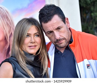 Jennifer Aniston Adam Sandler Images, Stock Photos & Vectors