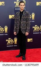 LOS ANGELES - JUN 16:  Brandon Flynn at the 2018 MTV Movie And TV Awards at the Barker Hanger on June 16, 2018 in Santa Monica, CA
