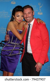 LOS ANGELES - JUN 17:  Jeannie Mai, husband arrive at the 38th Annual Daytime Creative Arts & Entertainment Emmy Awards at Westin Bonaventure Hotel on June 17, 2011 in Los Angeles, CA