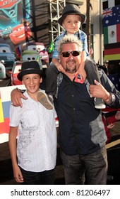 """LOS ANGELES - JUN 18:  GUY FIERI & KIDS arrives to the """"Cars 2"""" World Premiere  on June 18,2011 in Hollywood, CA"""