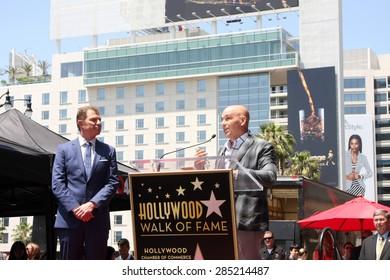 LOS ANGELES - JUN 2:  Bobby Flay, Michael Symon at the Bobby Flay Hollywood Walk of Fame Ceremony at the Hollywood Blvd on June 2, 2015 in Los Angeles, CA