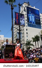LOS ANGELES - JUN 20:  Benny Medina, Jennifer Lopez at the Hollywood Walk of Fame star ceremony for Jennifer Lopez at the W Hollywood Hotel on June 20, 2013 in Los Angeles, CA