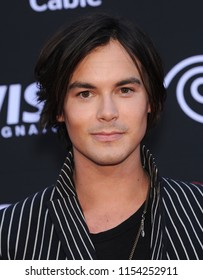 LOS ANGELES - JUN 22:  Tyler Blackburn arrives to the 'The Lone Ranger' Hollywood Premiere  on June 22, 2013 in Hollywood, CA