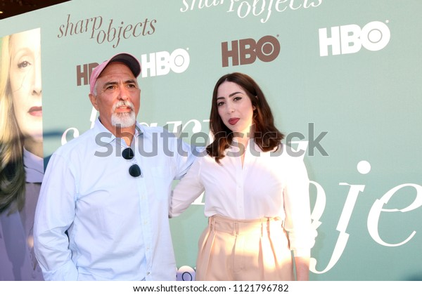 """LOS ANGELES - JUN 26:  Miguel Sandaval, Olivia Sandoval at the """"Sharp Objects"""" HBO Premiere Screening at the ArcLight Theater on June 26, 2018 in Los Angeles, CA"""