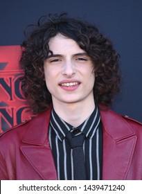 LOS ANGELES - JUN 28:  Finn Wolfhard arrives for the Netflix 'Stranger Things' Season 3 Premiere on June 28, 2019 in Santa Monica, CA
